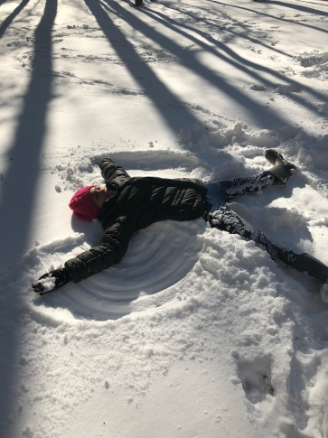 gabby making a snow angel